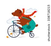 cute bear riding a bicycle in a ... | Shutterstock .eps vector #338718215