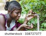 happy african schoolgirl... | Shutterstock . vector #338727377