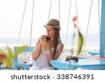 Girl Drinking Juice On The Beach