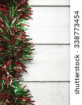 green and red christmas tinsel... | Shutterstock . vector #338773454