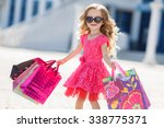 cute little girl on shopping.... | Shutterstock . vector #338775371