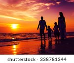 Family Walking On The Beach...