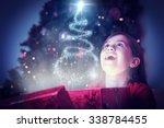 Little Girl Opening A Magical...