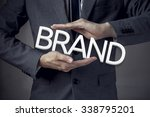 businessman in suit with two... | Shutterstock . vector #338795201