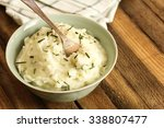 mashed potatoes in a bowl on... | Shutterstock . vector #338807477
