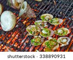scallop seashell on the grill... | Shutterstock . vector #338890931