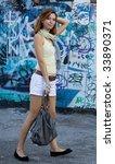 girl near graffiti wall | Shutterstock . vector #33890371