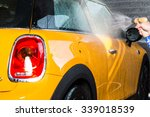 washing a car with water and...   Shutterstock . vector #339018539