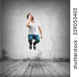 crazy man jumping | Shutterstock . vector #339053405