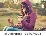 hipster girl sitting on rock... | Shutterstock . vector #339074375