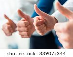 Small photo of Hands close-up. Group young business people talking at office
