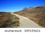 dirt road leading up a hillside ... | Shutterstock . vector #339155621
