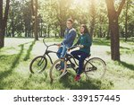cheerful young couple riding a... | Shutterstock . vector #339157445