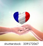 Two Human Hand Holding France...
