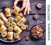hand holding turkish baklava... | Shutterstock . vector #339274931
