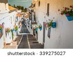 picturesque street of mijas... | Shutterstock . vector #339275027
