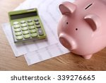pig moneybox and calculating... | Shutterstock . vector #339276665