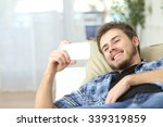 Постер, плакат: Happy man watching movies