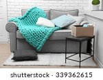 knitted woolen blanket on sofa  ... | Shutterstock . vector #339362615