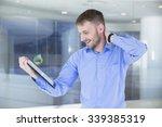 businessman looking in tablet... | Shutterstock . vector #339385319