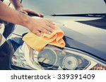 a man cleaning car with... | Shutterstock . vector #339391409