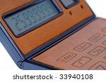 brown calculator on white... | Shutterstock . vector #33940108
