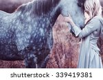 beauty blondie with horse in... | Shutterstock . vector #339419381