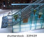 This is a shot of an escalator and a display at a New Jersey shopping mall. - stock photo