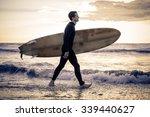 Surfer With Board Walking Along ...