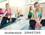 Small photo of Group of healthy women in a fitness class, fitness, sport, training, aerobics concept