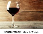 Glass Of Red Wine On Wooden...