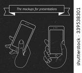 vector hand keeps smartphone... | Shutterstock .eps vector #339538301