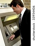 man at automatic teller machine - stock photo