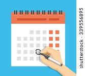 hand with pen mark calendar.... | Shutterstock .eps vector #339556895