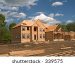This is a shot of a couple homes under construction. - stock photo