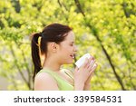 attractive woman outdoor with... | Shutterstock . vector #339584531