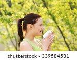 attractive woman outdoor with... | Shutterstock . vector #339584531