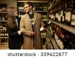 couple choosing alcohol in a... | Shutterstock . vector #339622877