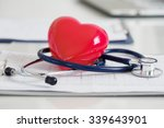 stethoscope and red heart lying ... | Shutterstock . vector #339643901