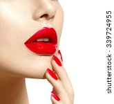 Red Sexy Lips And Nails Closeu...
