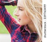 beautiful young woman outdoors...   Shutterstock . vector #339763499