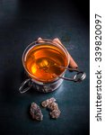 Glass Cup Of Tea With Tea Ball...