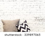 pillows on white brick wall... | Shutterstock . vector #339897065