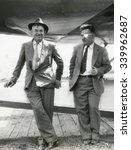 Will Rogers and Wiley Post before their ill-fated flying exploration of Alaska. The plane behind them was an unstable combination of a Lockheed Orion fuselage with wings from a different Lockheed airc