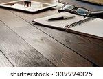 open notebook  tablet computer  ... | Shutterstock . vector #339994325