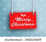 merry christmas logo on hanging ... | Shutterstock .eps vector #340024649