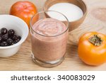 glass of persimmon smoothie... | Shutterstock . vector #340083029