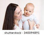 happy mother and infant baby... | Shutterstock . vector #340094891