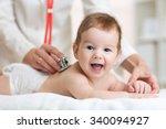 Pediatrician Doctor Examines...