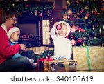 father and kids with presents... | Shutterstock . vector #340105619